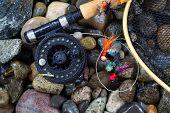 Wet Trout Fishing Gear On River Rocks