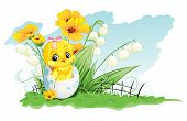 chicken in the egg and lilies of the valley on a background of yellow flowers