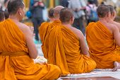 Yangon, Myanmar - November 22, 2014: Several Unidentified Buddhist Monks Pray At Shwedagon Pagoda