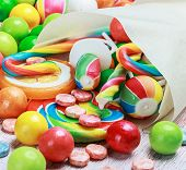 Lollipops And Candy On A Wooden Table