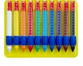 ten colored wax crayons isolated over white
