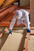Man Laying Thermal Insulation Layer - Wearing Protective Clothing