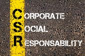 picture of responsible  - Acronym CSR - Corporate Social Responsability. Business Conceptual image with yellow paint line on the road over asphalt stone background. - JPG