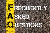 foto of faq  - Acronym FAQ - Frequently Asked Questions. Business Conceptual image with yellow paint line on the road over asphalt stone background. - JPG