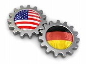 stock photo of snatch  - USA and German flags on a gears - JPG