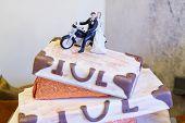 foto of three tier  - Elegant wedding cake in white with three levels - JPG