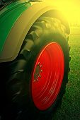 picture of cultivator-harrow  - Agricultural equipment in sunset light - JPG