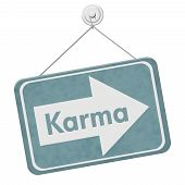 stock photo of karma  - Karma Sign A blue sign with the words Karma isolated on white - JPG