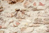 image of fortified wall  - Stone wall abstract light texture or background - JPG