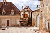 picture of quaint  - Quaint street in a town in Burgundy France with small timbered house - JPG