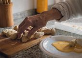 stock photo of grandma  - Grandma croquettes. Preparing homemade croquettes at home ** Note: Soft Focus at 100%, best at smaller sizes - JPG