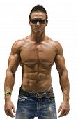 picture of nake  - Attractive young man with naked muscular torso, wearing jeans and sunglasses, isolated on white background