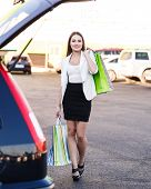 image of shopping center  - Woman after shopping in a mall or shopping centre and driving home now with her car - JPG