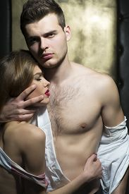 stock photo of hot couple  - Hot young couple with beautiful bodies vertical picture - JPG
