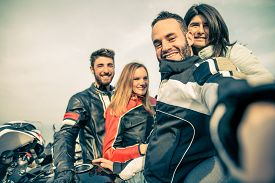 picture of biker  - Bikers taking selfie with camera  - JPG