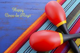 picture of mexican fiesta  - Happy Cinco de Mayo background with colorful maracas on Mexican theme dark blue distressed table with copy space - JPG