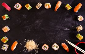 pic of soy sauce  - Overhead shot of sushi on dark background - JPG
