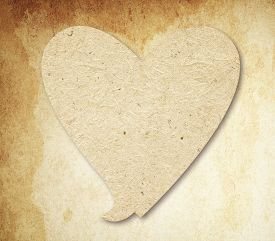 stock photo of bubble sheet  - Heart speech bubble  with shadow on brown vintage paper - JPG