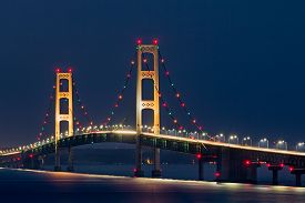 picture of suspension  - Colorful lights decorate the Mackinaw Bridge a long suspension bridge and engineering marvel crossing the Straits of Mackinac and connecting Michigan - JPG