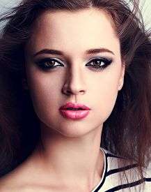 pic of blown-up  - Beautiful makeup woman with pink lipstick and smoky eyes make - JPG