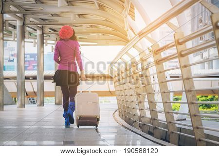 poster of Woman Traveller In Airport Walkway. Travel Concept.