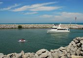 stock photo of waverunner  - Boat entering the Racine WI Harbor from Lake Michigan - JPG