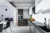 Modern Kitchen With Rustic Ceiling poster