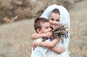 Young bride and groom playing wedding summer outdoor. Children like newlyweds. Little girl in bride  poster