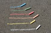 Color Lines And Crayon At Asphalt