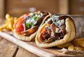two tasty wrapped greek lamb gyros poster
