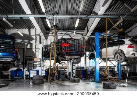 poster of Car Repair On A Lift For The Repair Of The Chassis, Automatic Transmission And Engine In The Auto Re