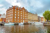 View Of Copenhagen From A Pleasure Boat. Colorful Scandinavian Residential Houses Buildings And Boat poster