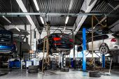 Car Repair On A Lift For The Repair Of The Chassis, Automatic Transmission And Engine In The Auto Re poster