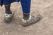 Traditional Tribal Bead Work Worn Around Ankle By Masai Man, Also Wearing Very Old And Worn Sandals. poster