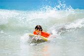Child Surfing On Tropical Beach. Surfer In Ocean. poster