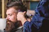 Barbershop Concept. Hands Of Barber With Hair Clipper, Close Up. Hipster Bearded Client Getting Hair poster