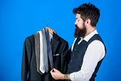 Matching Necktie With Outfit. Man Bearded Hipster Hold Neckties And Formal Suit. Guy Choosing Neckti poster