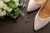 Beautiful Wedding Bouquet Of Flowers Rings Bridal Shoes On Wooden Background. Declaration Of Love, S poster