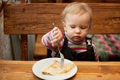 Blond Little Girl Eats Pancakes