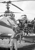 Flight Ahead. Helicopter Tour And Travel. Family Vacation. Family Couple With Child On Vacation Trip poster