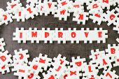 Self Improvement Or Positive Motivation Concept, White Puzzle Jigsaw With Alphabet Building The Word poster