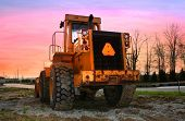 picture of heavy equipment  - Construction equipment with bright colored sky background - JPG
