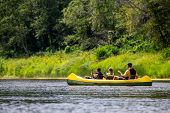 Family In Yellow Kayak Drives On The River. People Boating On River Gauja In Latvia, Peacefull Natur poster