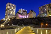 A Scenic Lit Up Walkway Leading To Downtown Edmonton poster