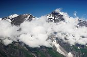 Grossglockner High Mountains With Clouds And Frosen Snow