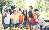 Happy Friends Having Fun Together At Pic Nic Barbecue Party - Young Millenial People At Picnic On Op poster