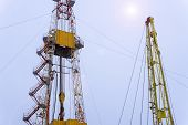 Silhouette Image Of Oil And Gas Drilling Rig In The Middle Of Nowhere With Dramatic Sky. Onshore Lan poster