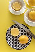 Fresh Raw Lemons And Porcelain  Tablewares On Fresh Yellow Background. Still Life, Background, Fresh poster