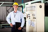 male industiral engineer portrait in factory