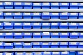 Blue Plastic Boxes In Storage Stand